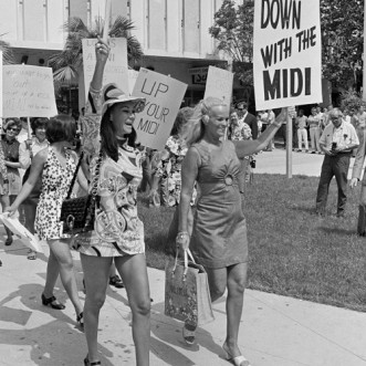 Mini-skirted women march in protest of the midi skirt, July 13, 1970, in Miami, Fla. The women are afraid stores will stop stocking the mini skirt and they want freedom of choice in their attire. (AP Photo/Jim Kerlin)